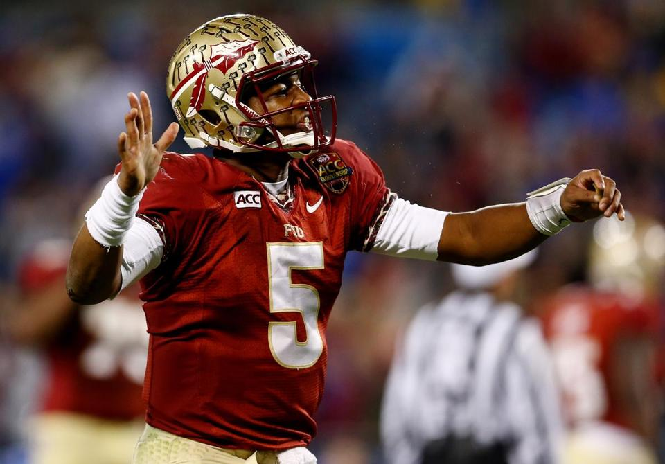 Florida State quarterback Jameis Winston, the Heisman Trophy favorite, threw for three touchdowns and ran for another.